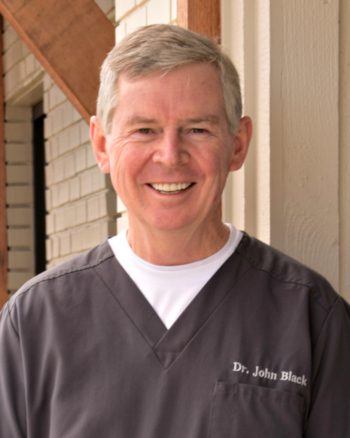 Dr. John T. Black in front of his dental practice